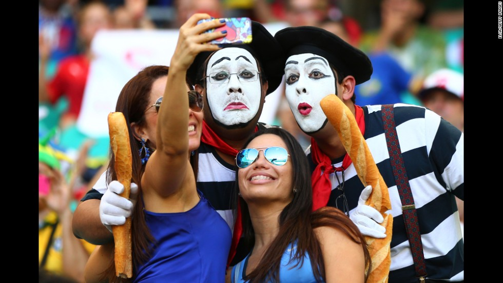 France fans pose for a selfie during the match.
