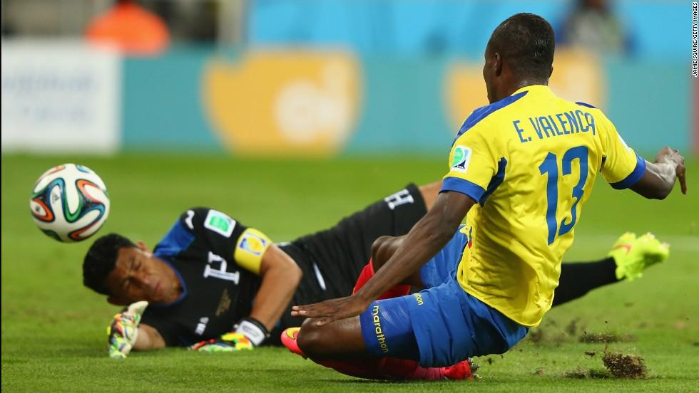 Enner Valencia of Ecuador scores the first goal of the game past Noel Valladares of Honduras.