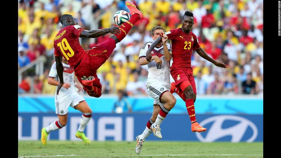Jonathan Mensah, left, of Ghana in action.