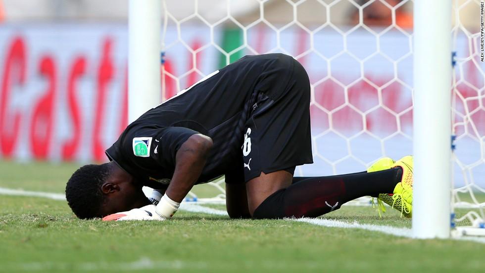 Goalkeeper Fatawu Dauda of Ghana prays prior to the match against Germany in Fortaleza, Brazil.