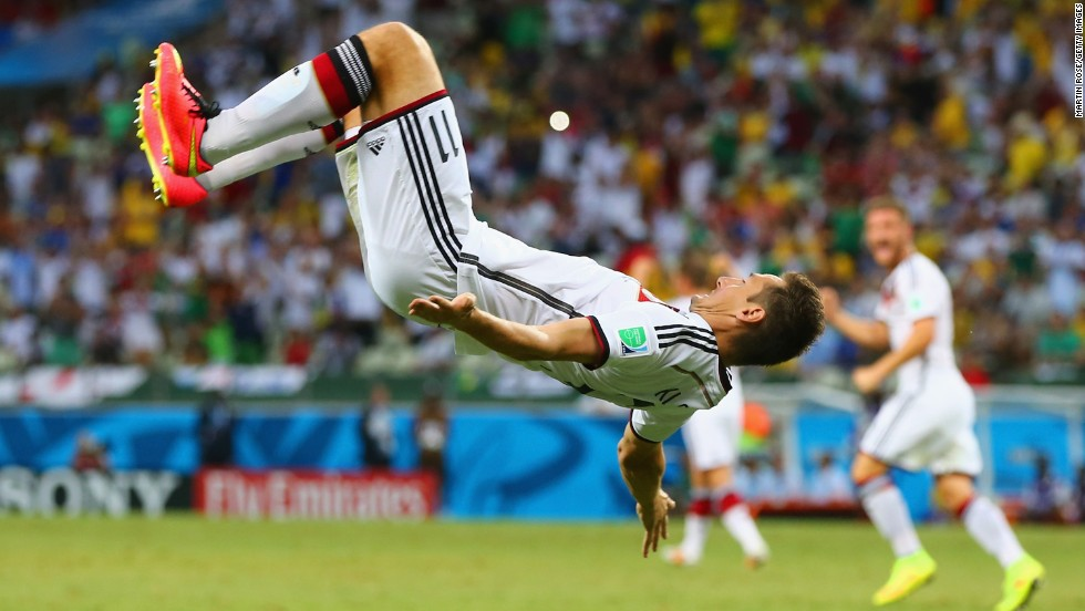 Germany substitute Miroslav Klose does a flip to celebrate after equaling the World Cup record of 15 goals overall, giving his team a 2-2 draw with Ghana on June 21 in Fortaleza, Brazil.