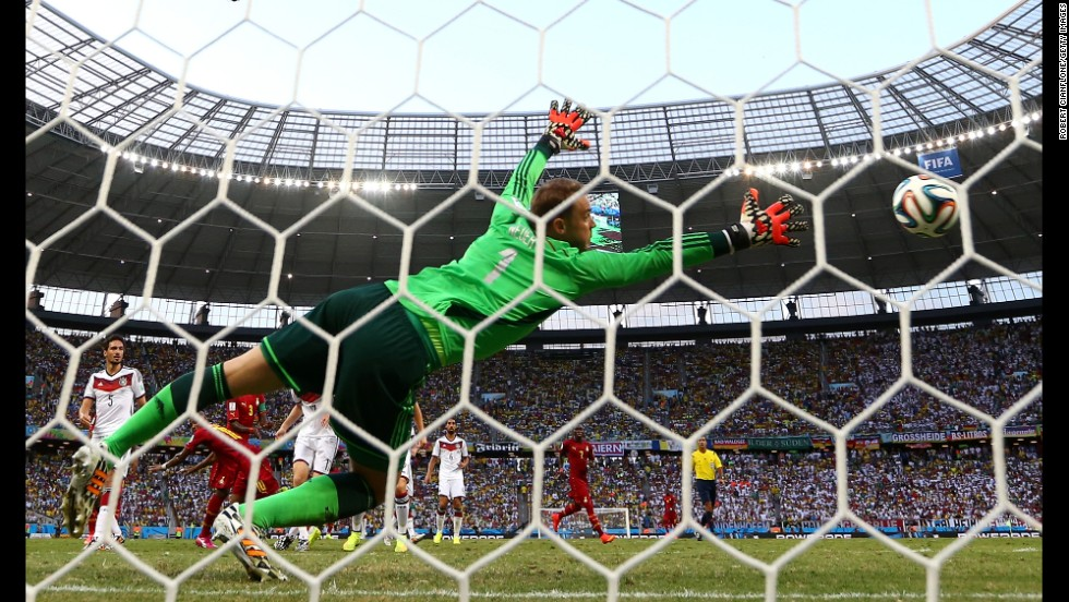 Andre Ayew scores Ghana's equalizer with a header past Germany goalkeeper Manuel Neuer.