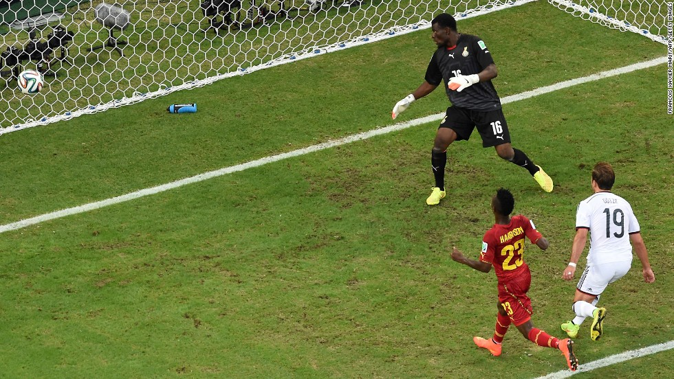 Germany midfielder Mario Gotze, right, scores the team's first goal against Ghana.