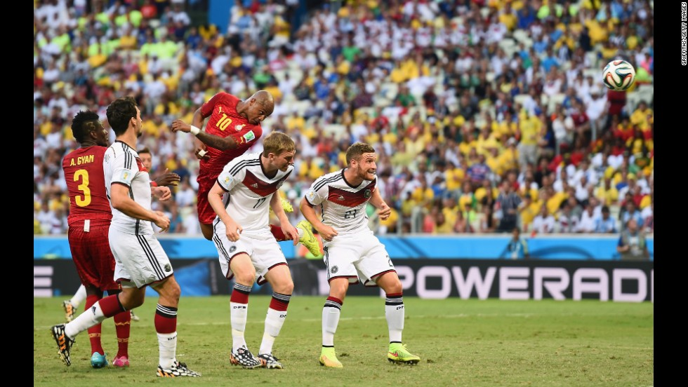 Andre Ayew of Ghana scores his team's first goal on a header over Per Mertesacker and Shkodran Mustafi of Germany.