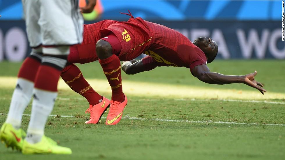 Ghana defender Jonathan Mensah falls.