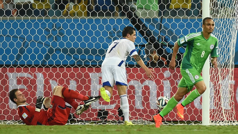Nigeria forward Peter Odemwingie, right, shoots past Bosnia-Herzegovina goalkeeper Asmir Begovic, left, on Saturday, June 21, in Cuiaba, Brazil. Nigeria won 1-0.