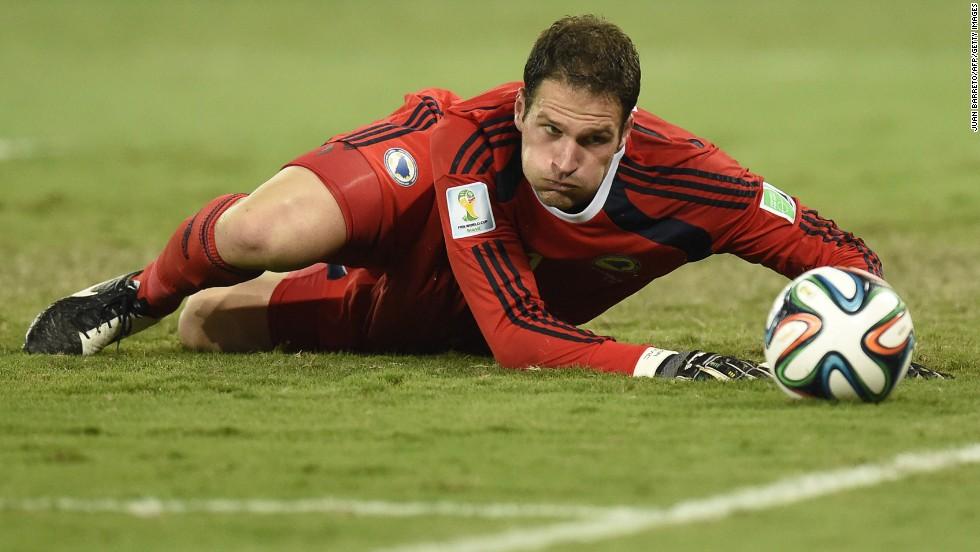 Bosnia-Herzegovina goalkeeper Asmir Begovic eyes the ball