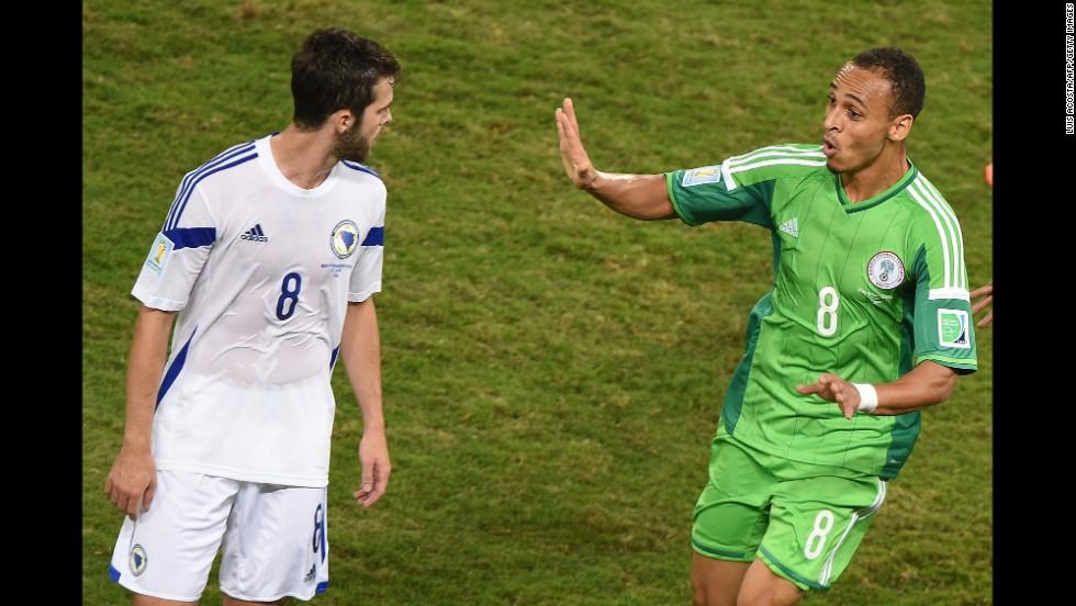 Nigeria forward Peter Odemwingie, right, celebrates near Bosnia midfielder Miralem Pjanic after scoring a goal.