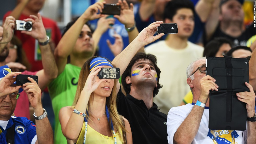 Fans snap photos during the match between Nigeria and Bosnia-Herzegovina.