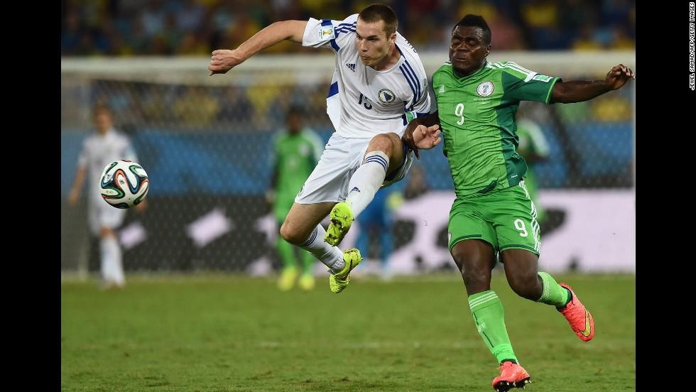 Nigeria forward Emmanuel Emenike, right, challenges Bosnia-Herzegovina defender Toni Sunjic.