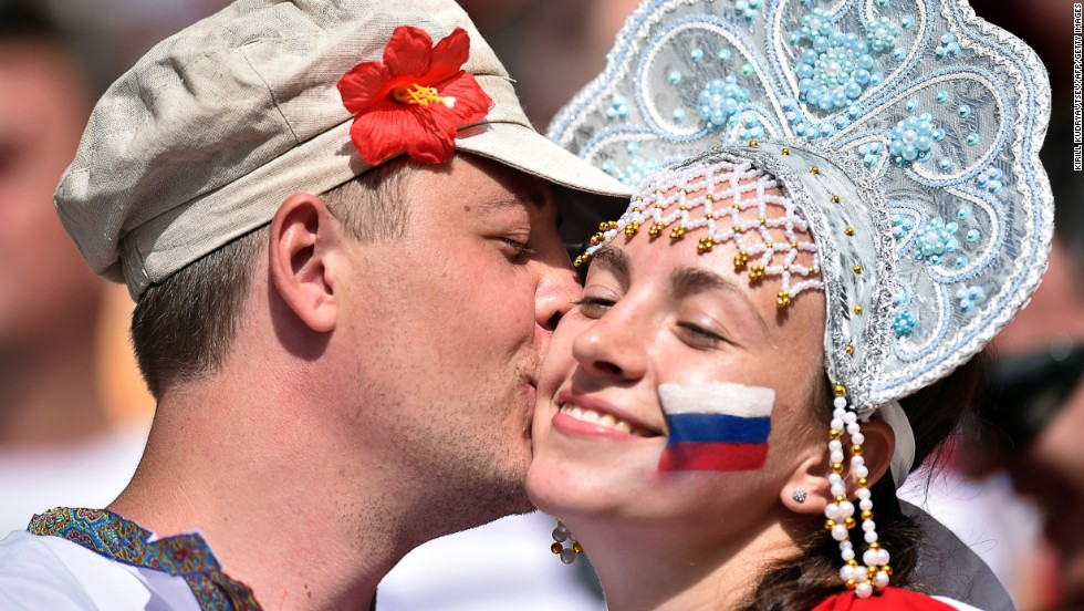 Russia supporters kiss during the game.