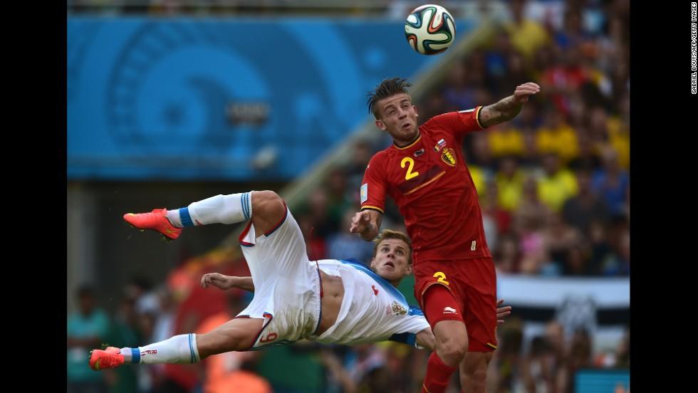 Belgian defender Toby Alderweireld heads the ball past Russian forward Alexander Kokorin.