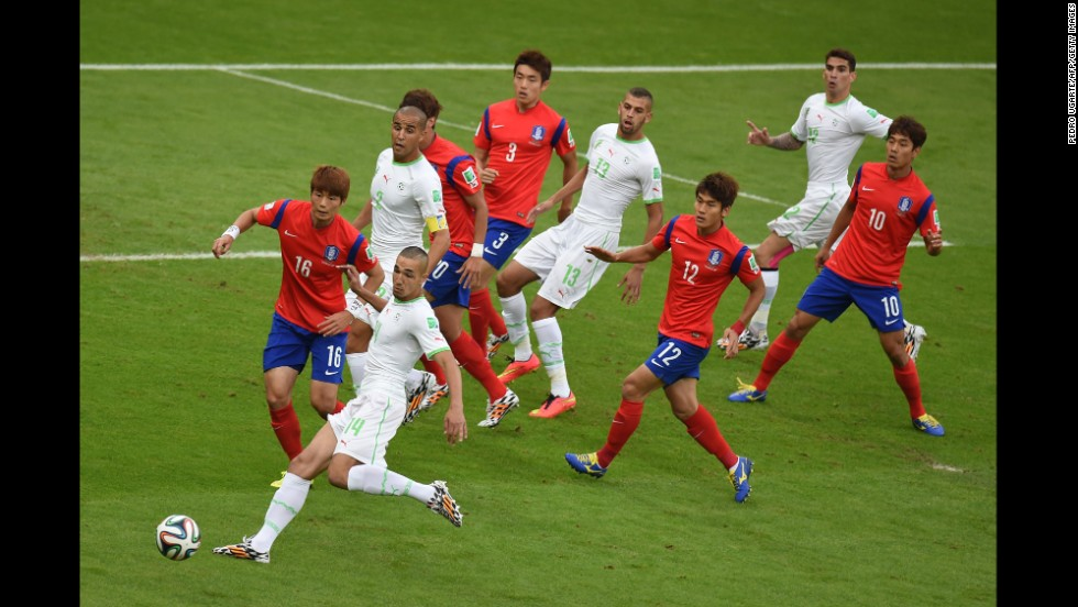 Algerian midfielder Nabil Bentaleb, second left, competes for the ball with South Korean midfielder Ki Sung-yueng, first left, on June 22.