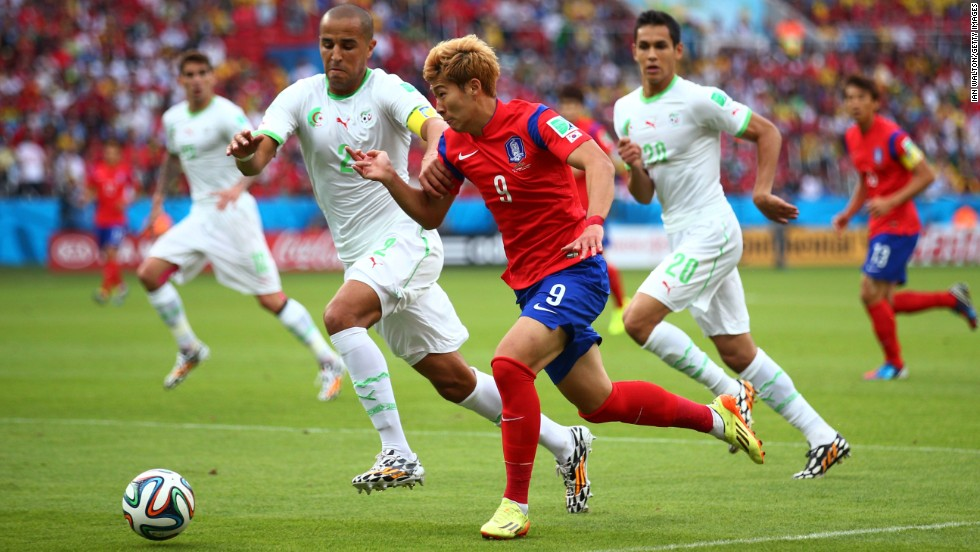 Son Heung-min of South Korea controls the ball against Madjid Bougherra of Algeria.