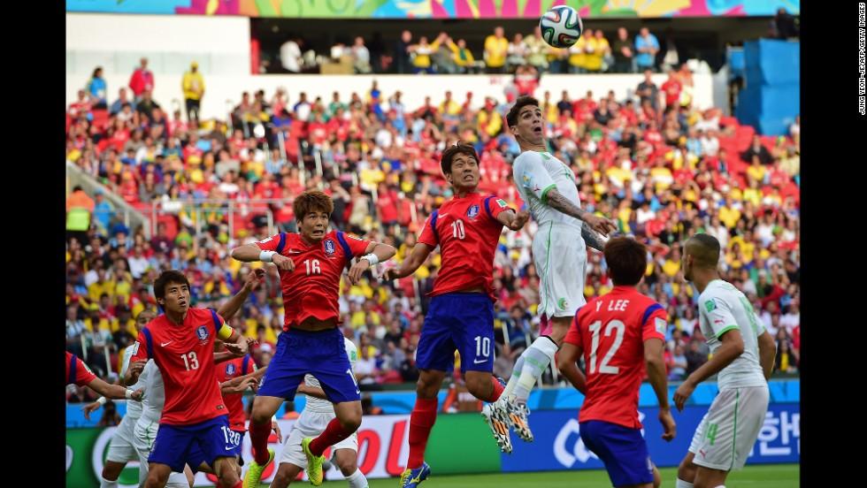 Algerian defender Carl Medjani jumps to head the ball.
