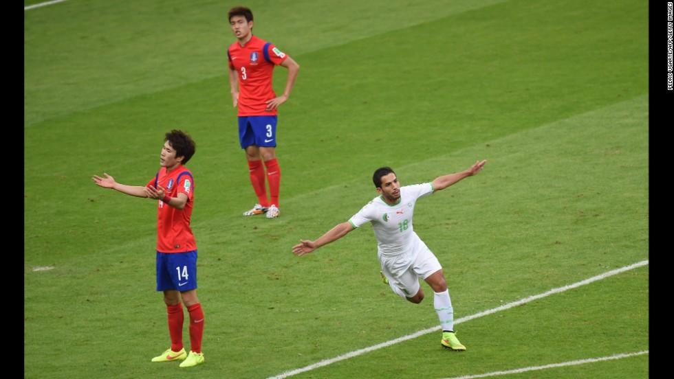 Algerian forward Abdelmoumene Djabou celebrates scoring his team's third goal against South Korea.