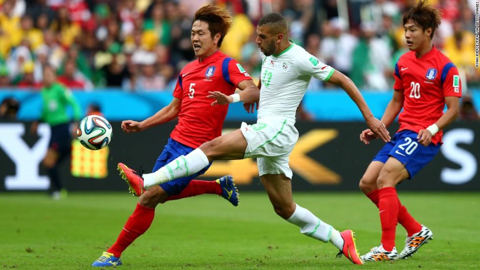 Islam Slimani of Algeria scores the first goal against South Korea.