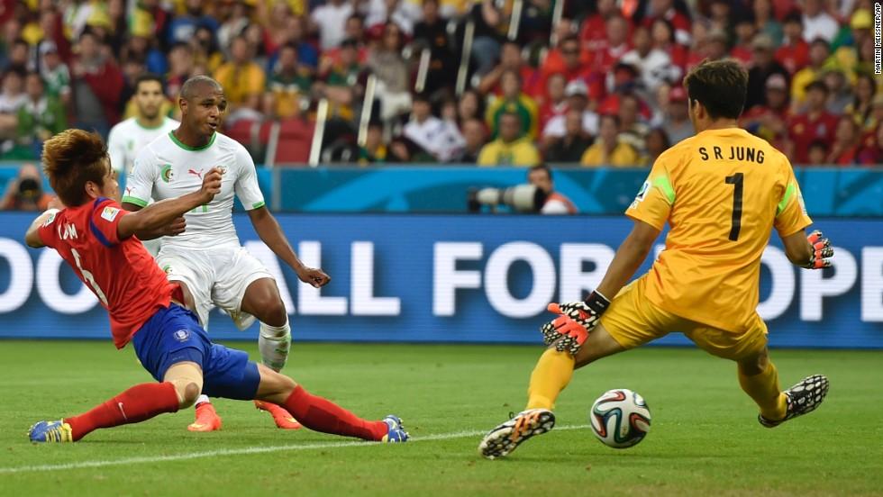 Yacine Brahimi, second left, scores Algeria's fourth goal against South Korea.