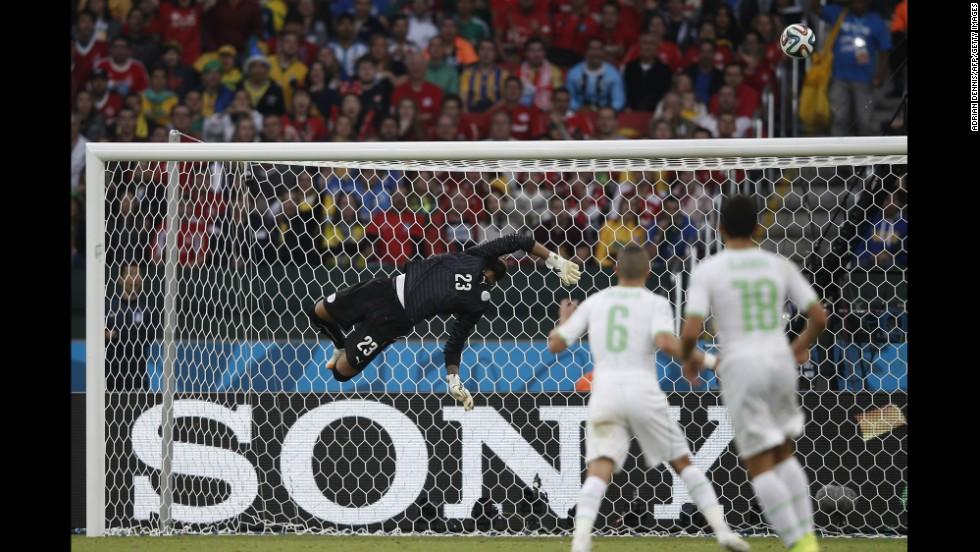Algeria's goalkeeper Rais M'bohli makes a save.
