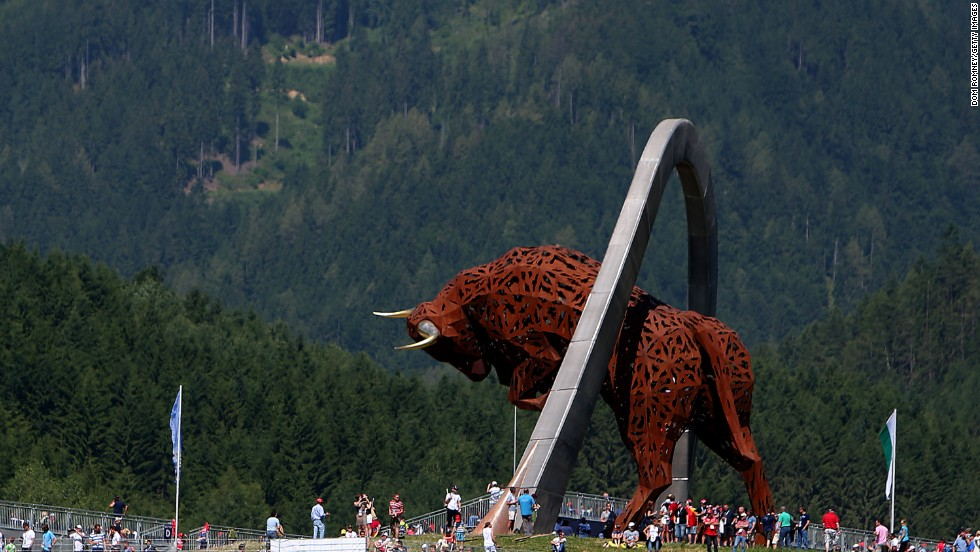 Fans walk around a giant Red Bull sculpture before the race at the revamped Red Bull Ring in the town of Spielberg. The grand prix was the first to be held in Austria in 11 years.