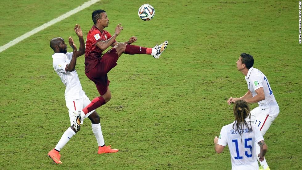 Portugal forward Nani jumps for the ball.