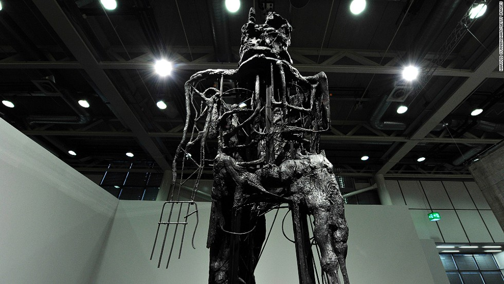 """<em>""""Striding Figure II (Ghost)"""" (2012) by British artist Thomas Houseago</em><br /><br />So how do you strike a balance between the rarefied atmosphere of artistic endeavor, and the nitty-gritty of commercial transactions? """"If people weren't selling art here, than there would be no fair,"""" says Spiegler. """"The success of the commercial galleries here is a sine qua non in the equation."""" Large scale work of British-born Los Angeles-based artist <a href=""""http://www.saatchigallery.com/artists/thomas_houseago.htm"""" target=""""_blank"""">Thomas Houseago</a>, like the one shown above, fetch in the region of $750,000."""