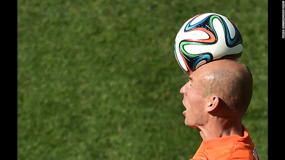 Netherlands forward Robben heads the ball.