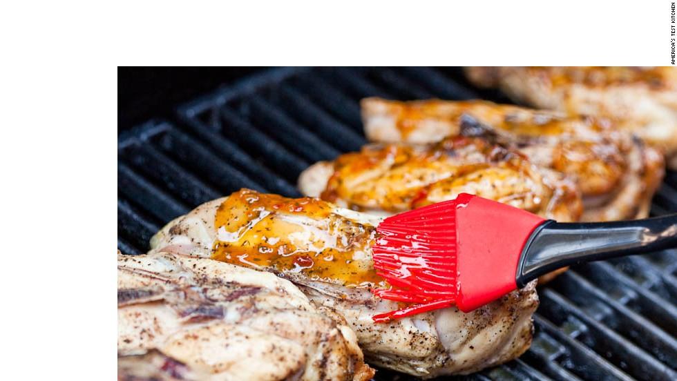 6. Brush bone side of chicken with glaze.