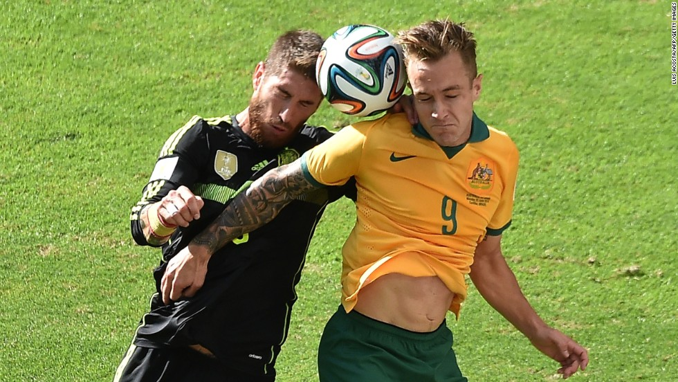 Spain defender Sergio Ramos, left, vies with Australia forward Adam Taggart.