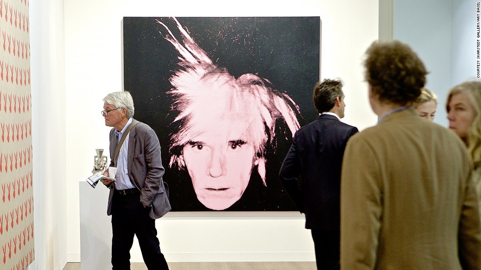 "<em>""Self-Portrait (Fright Wig)"" (1986) by American artist Andy Warhol</em><br /><br />The event has a decidedly international flair, and not just when it comes to galleries and artists represented -- collectors from Asia, Middle East, North America and Eastern Europe all fly in to the picturesque Swiss town specially for the show. They do more than just browsing -- this year's biggest sale was a self-portrait by the legendary American pop-artist Andy Warhol, shown above, which went for $35m."