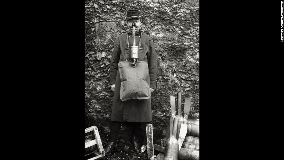 "A soldier demonstrates an ungainly French gas mask. ""French masks were notoriously unreliable,""<a href=""http://www.ncbi.nlm.nih.gov/pmc/articles/PMC2376985/"" target=""_blank""> wrote</a> historian Gerald Fitzgerald."