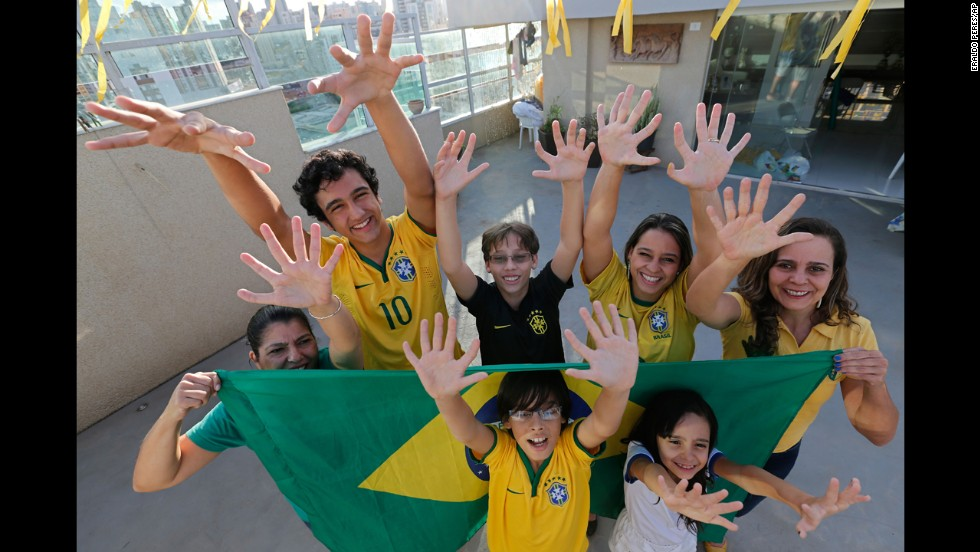 Members of the six-fingered Silva family are seen at their home in Brasilia, Brazil, on Thursday, June 19. Everyone in their family was born with an extra digit on each hand as a result of a genetic condition known as polydactyly. They're hoping to bring the Brazilian soccer team extra luck in the World Cup.