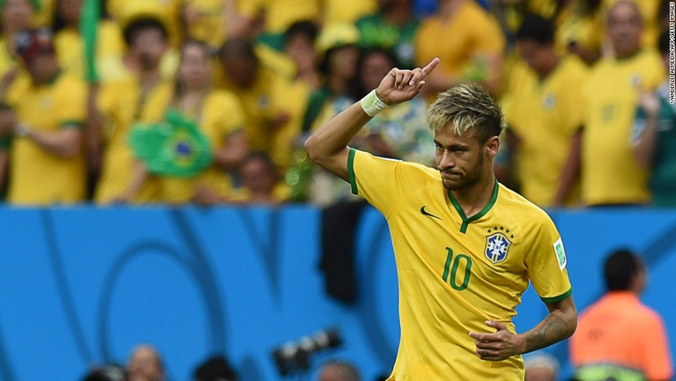 Neymar celebrates after scoring a goal against Cameroon.
