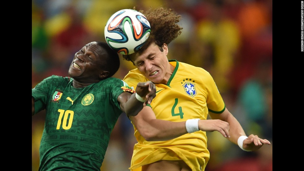Brazilian defender David Luiz, right, vies with Cameroon forward Vincent Aboubakar.