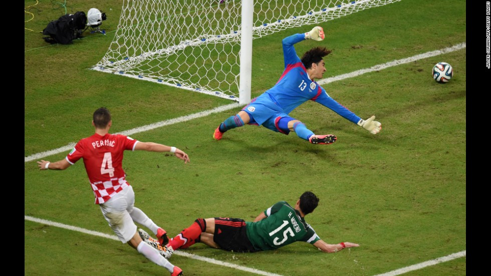 Goalkeeper Guillermo Ochoa of Mexico fails to stop Croatian midfielder Ivan Perisic from scoring on Monday, June 23, in Recife, Brazil. Mexico won 3-1.