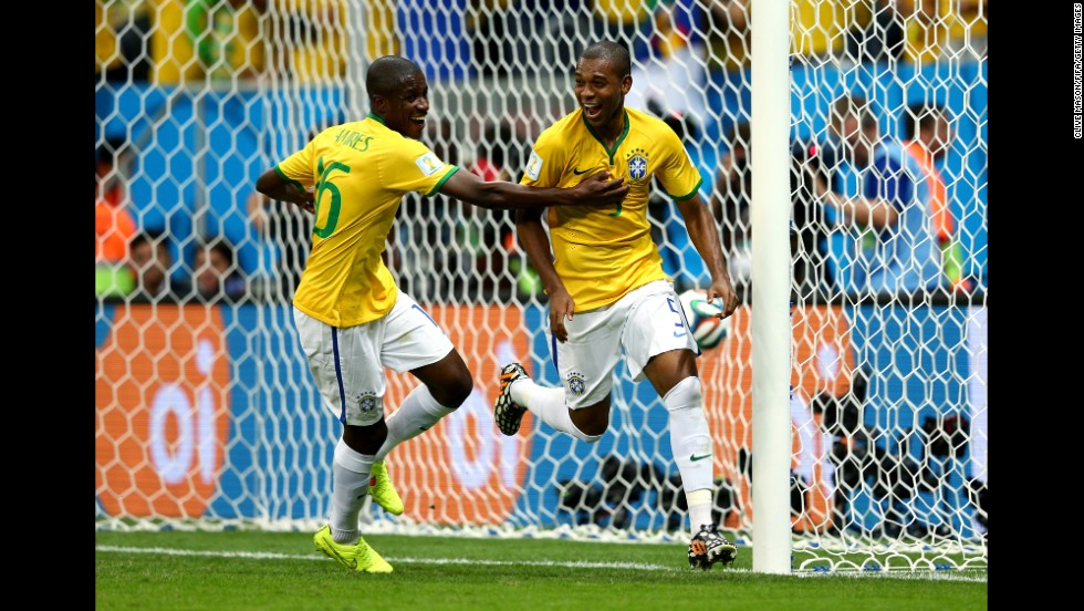 Fernandinho of Brazil, right, celebrates with his teammate Ramires after scoring his team's fourth and final goal against Cameroon on June 23 in Brasilia. Brazil won 4-1.