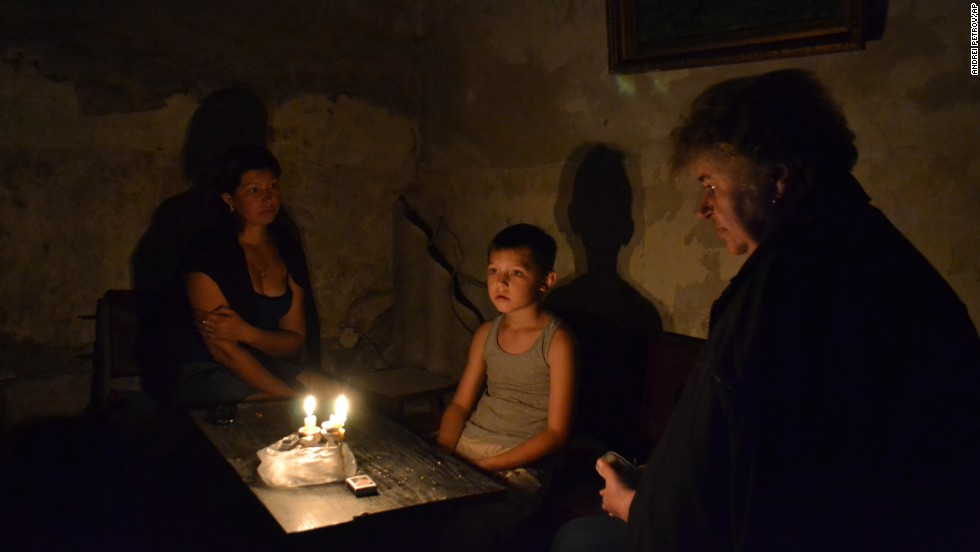 People take refuge in a bomb shelter during clashes between Ukrainian troops and pro-Russia fighters in Slovyansk on Sunday, June 22.