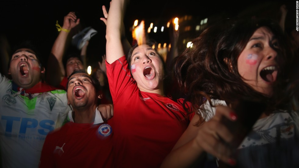 Fans in Rio de Janeiro react after Chile scored against Australia on Friday, June 13. Chile won the match 3-1.