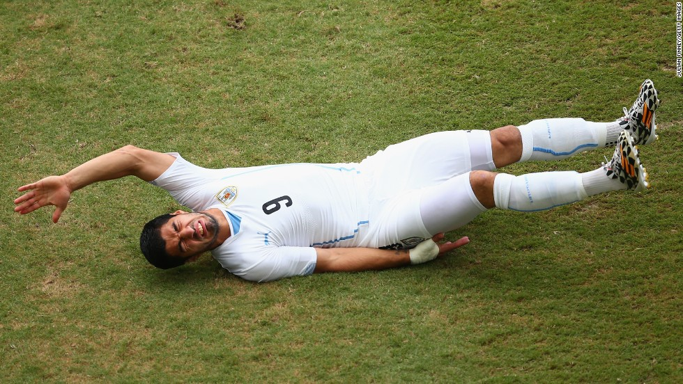 Luis Suarez of Uruguay reacts during a fall.