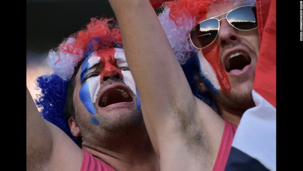 Supporters of the Costa Rican soccer team cheer before their game against Uruguay on Saturday, June 14. Costa Rica upset Uruguay 3-1.