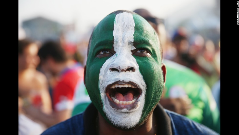 A Nigeria supporter watches his team play against Iran on June 16.  It ended 0-0.