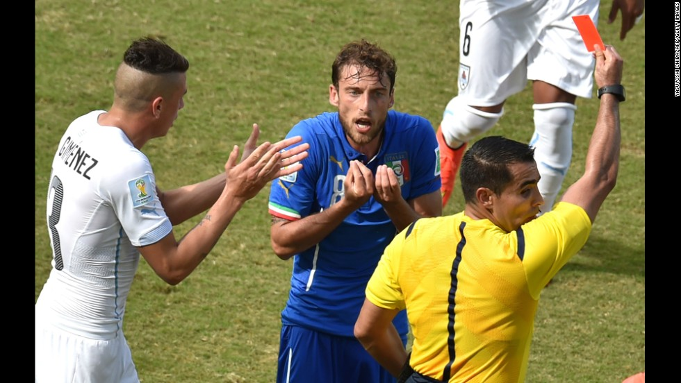 Italy midfielder Claudio Marchisio, center, reacts as he is shown a red card by referee Marco Antonio Rodriguez Moreno.