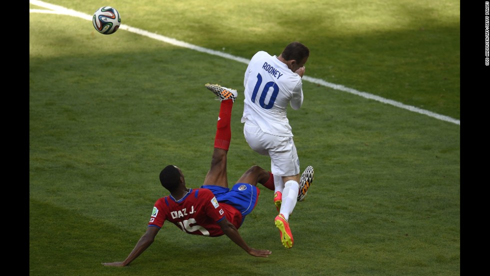 England forward Wayne Rooney, right, reacts after a challenge from Costa Rica defender Junior Diaz.