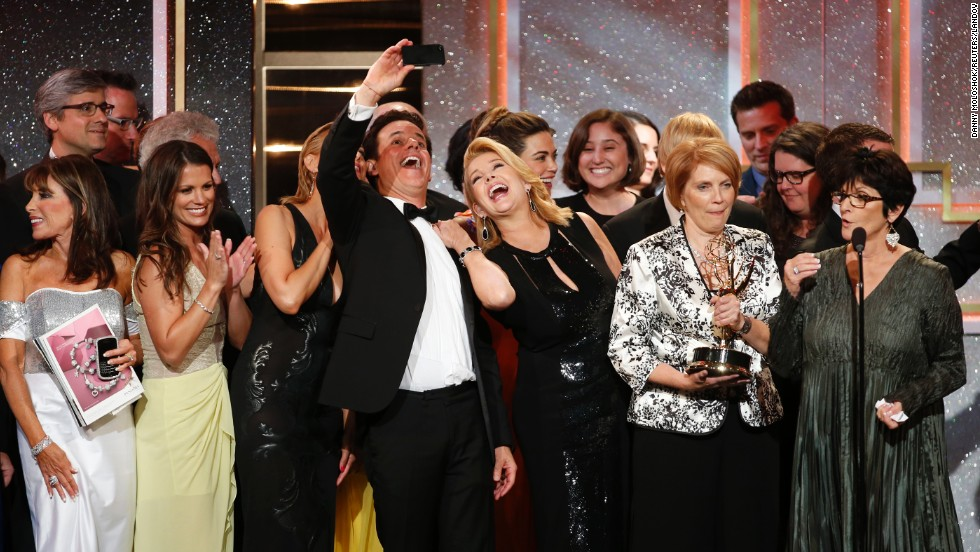 "The cast and crew of ""The Young and the Restless"" take a selfie as they accept the award for outstanding drama series during the 41st Annual Daytime Emmy Awards on Sunday, June 22, in Beverly Hills, California."