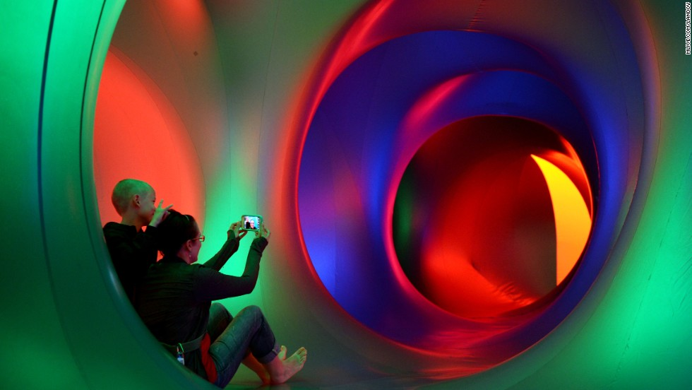 Visitors take a selfie inside of the Miracoco luminarium during Ann Arbor Summer Fest at Palmer Field on Friday, June 20, in Ann Arbor, Michigan.