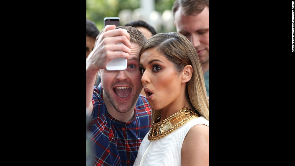 "English recording artist Cheryl Cole poses for a selfie with a fan at the London auditions for ""X Factor"" on Tuesday, June 24."