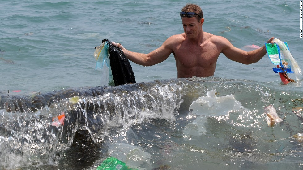 """Doug Woodring, co-founder of <a href=""""http://www.oceanrecov.org/"""" target=""""_blank"""">Ocean Recovery Alliance</a>, an NGO, displays rubbish on a beach on the south side of Hong Kong in 2009."""