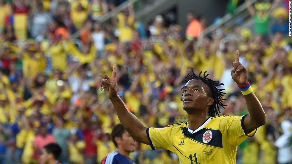 Colombia's Juan Guillermo Cuadrado celebrates after scoring a penalty.