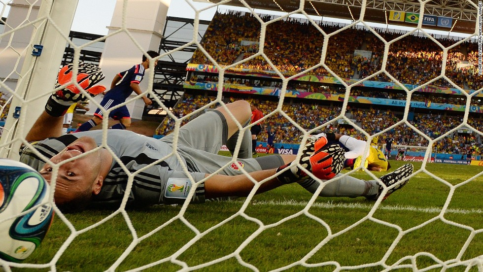 Colombia's goalkeeper David Ospina lies on the ground after Japan's Shinji Okazaki (not pictured) scored his team's first goal.