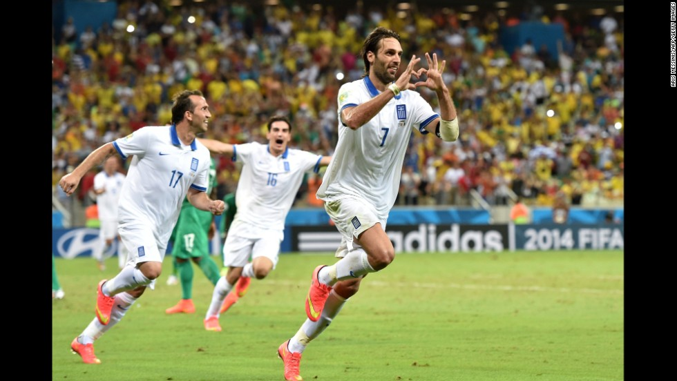 Greece's Georgios Samaras, right, celebrates scoring a penalty.